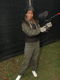 Tania Spice gets dressed up on her paintball gear and has some fun pictures at lingerie-mania.com