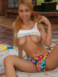Tania has fun in pigtails and fucks her ass with a chrome toy pictures at freekilopics.com