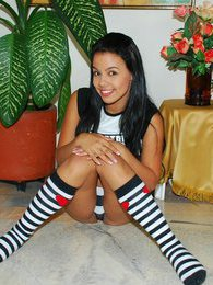 Gigi Spice gets horny wearing her tube socks and plays with a purple vibrator pictures
