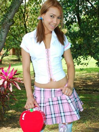 Tania Spice plays with her pussy after a school day wearing high stockings pictures at kilosex.com
