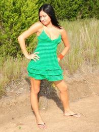 Cierra Spice becomes one with nature as she takes her green dress off in the woods pictures