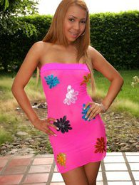 Tania wears a tight pink dress and has a little ladybug vibrator that she has some fun with pictures