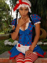 Isabella has some naughty fun dressed as a doll pictures at kilosex.com
