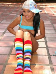 Gigi gets wild with her rainbow socks and anal beads pictures at kilosex.com