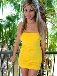 Kristin shows us whats underneath that yellow dress she is wearing pictures