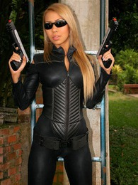 Tania Spice gets all hot and bothered after wearing her tomb raider suit pictures at find-best-tits.com