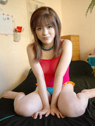 Japanese slut shows off thigh high stockings and lifts shirt for a look at big tits pictures at freekilosex.com