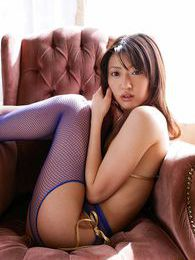 Japanese beauty is fingering her pussy through her crotchless fishnet stockings pictures