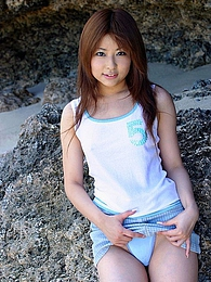 Japanese beach bunny shows off her lovely body nude at the beach in the sun pictures at freekilosex.com