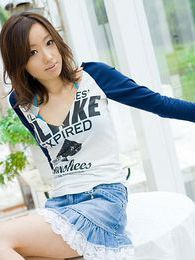 Cute Japanese teen model in a mini skirt enjoys teasing the guys taking off clothes pictures at freekilopics.com