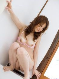Hot Japanese doll enjoys modeling her lingerie and showing her hot body off pictures at freekilosex.com