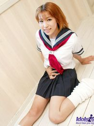 Yuri is an Japanese slut who enjoys teasing the guys when she wears her sailor suit pictures at lingerie-mania.com