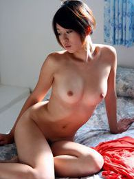 Japanese model Rika takes off her dress and shows off her perfect ass and big tits pictures at kilosex.com