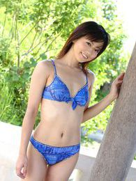 Lovely Japanese model smiles as she poses in her bikini on the beach pictures at lingerie-mania.com