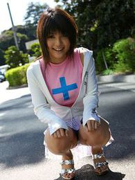 Gorgeously cute Japanese teen enjoys showing off her round tight ass and legs pictures at freekilosex.com