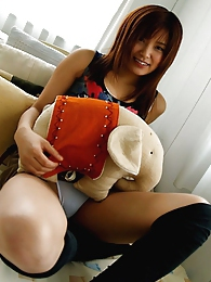 Smiling Japanese babe is a huge cock tease when she flashes her hot body pictures at kilomatures.com
