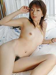 Japanese cutie shows off her hot lingerie and her naked body and smiles pictures at freekilosex.com