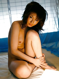 Beautiful Japanese babe is posing and showing off her great tits and ass before sex pictures at kilosex.com