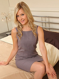 Elle is wearing a shift dress with tan stockings pictures