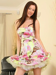 Brunette Carole wearing a beautiful and colourful summer dress pictures