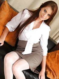 Laura in white suspenders and tight blouse pictures at lingerie-mania.com