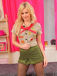 Sexy scout girl feels naughty and removes her uniform pictures at lingerie-mania.com