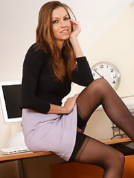Secretary shows a sexy strip in her office pictures