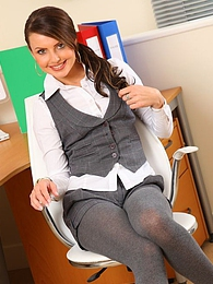 Beautiful secretary removes her shorts and vest to reveal sexy lingerie pictures at kilovideos.com