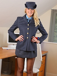 Gorgeous blonde undresses out of her military uniform pictures