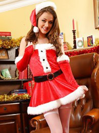 Jess Impiazzi makes for a real treat at christmas in her sexy santa outfit pictures at freekilosex.com