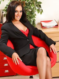 Abbie teases her way from office outfit with red and black suspenders pictures at freekilosex.com