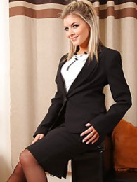 Blondge Naomi shows her naughty side in mini skirt and black stockings pictures at freekilomovies.com
