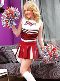 Hannah B hides cute white lingerie beneath her cheerleader's outfit pictures at freekilosex.com