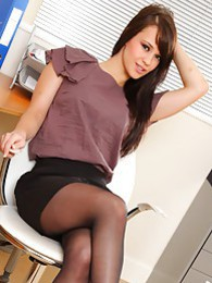 Amazing Emma looks stunning in the office in black pantyhose pictures