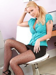 Jessica Roe unbuttons her blouse and slips off the tight miniskirt to show a teasing strip pictures