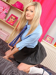 Naughty new college girl Elle slips out of her uniform pics