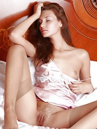Anna in a silk chemise and tan stockings pictures at freelingerie.us