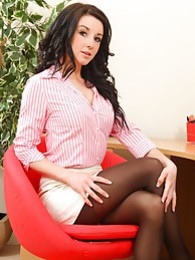 Pretty brunette strips out of her office clothes after a long day at work pictures at freekilosex.com