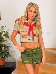Cheeky blonde cookie girl looks amazing as she strips out of her uniform and flaunts her hot body in just knee high socks pictures at kilosex.com