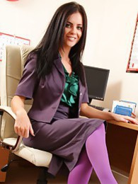 The beautiful Emma Glover in her office outfit and stockings pictures at kilomatures.com