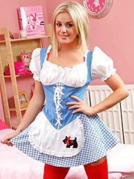 Stunning Amy Green in maids outfit and red suspenders pictures at find-best-babes.com