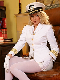Cute Ashlea looks wondeful dressed in her white uniform and matching white lingerie pictures at freekiloclips.com