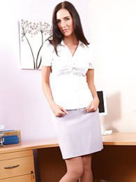 Sassy secretary in a tight white blouse and lilac pencil skirt pictures at lingerie-mania.com