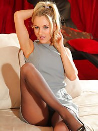 Natasha Anastasia in a grey minidress black pantyhose and heels pictures at lingerie-mania.com