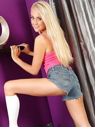 Lucy Anne shows off her shapely legs in her cropped denim hotpants and knee high socks pictures at kilosex.com