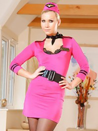 Beautiful air hostess in a tight pink minidress tights and heels pictures at find-best-panties.com