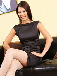Sabrina in her little black dress and stockings pictures at find-best-babes.com