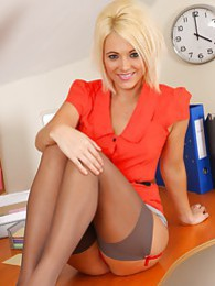 Gorgeous blonde teases in her office uniform and red lingerie pictures at lingerie-mania.com