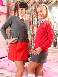 Two naughty college girls strip out of uniforms and stay in nothing but white cotton socks and high heels pictures at kilogirls.com