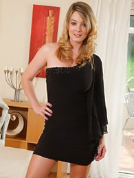 Marvellous beauty in sexy one shoulder covering mini dress and tan hold ups pictures at adspics.com